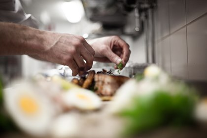 chef prepares food in the restaurant